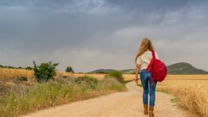 Woman walking down an empty road